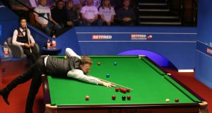 Judd Trump beat Thepchaiya Un-Nooh 10-9 to avoid a shock first round exit at the Crucible. Photograph: Nigel French/PA