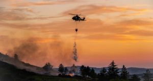 An Air Corps helicopter drops water on a gorse fire in Co Donegal at the weekend. Photograph: Air Corps/Facebook