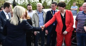 Michelle O'Neill and Arlene Foster shake hands at a rally for journalist Lyra McKee in Derry. Photograph: Charles McQuillan/Getty Images