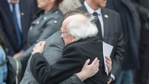 President Michael D Higgins offers his condolences to Lyra McKee's partner Sarah Canning after the funeral service in Belfast. Photograph: EPA
