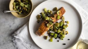 Yotam Ottolenghi's salmon: pan-seared salmon with celery, olives and capers. Photograph: Andrew Scrivani/NYT
