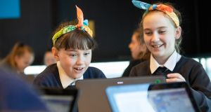 Caoimhe Curtis (left) and Erin Rave from St Kevin's Girls' National School, Kilnamanagh marking Girls in ICT Day at Microsoft in Dublin. Photograph: Naoise Culhane