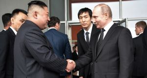 Russian president Vladimir Putin and North Korean leader Kim Jong-un shake hands talks in Vladivostok on Thursday.  Photograph: Alexey Nikolsky/Sputnik/EPA
