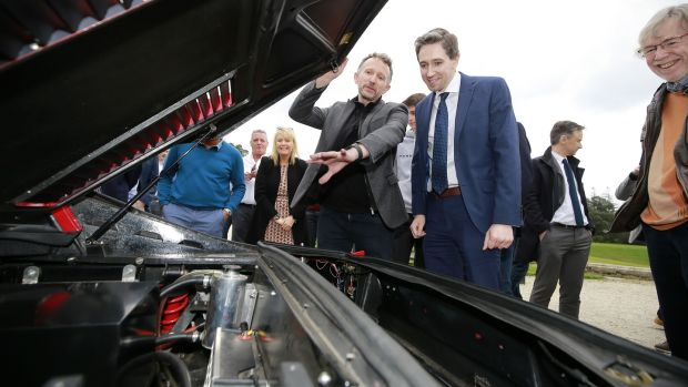 Electrifi founder Norman Crowley with Minister for Health Simon Harris at the car company's launch in April. Photograph: Nick Bradshaw