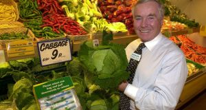 Feargal Quinn in the Blackrock Superquin store  showing the  lowered price of some veg. Photograph: Alan Betson