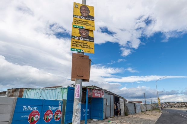 An election poster for South African president Cyril Ramaphosa looms over a coffee shop in Khayelitsha, Cape Town on April 23rd. Photograph: Nic Bothma/EPA