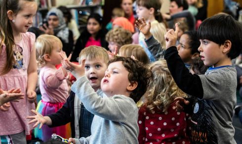 Oliver Moore enjoying peek a boo during Story, Rhythm and Rhyme with Deirdre Ryan during Cork World Book Fest at Cork City Library. Photograph: Clare Keogh