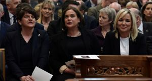 DUP's Arlene Foster  with Sinn Féin's Mary Lou McDonald and Michelle O'Neill at the funeral service for murdered journalist Lyra McKee in Belfast on Wednesday. Photograph:  Charles McQuillan/Pool via Reuters