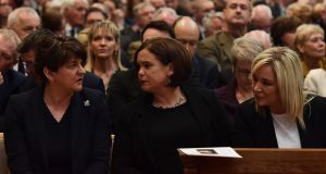 DUP leader Arlene Foster, Sinn Féin leader Mary Lou McDonald and deputy leader Michelle O'Neill at  funeral service of journalist Lyra McKee at St Annes Cathedral, Belfast. Photograph: Charles McQuillan/Getty Images