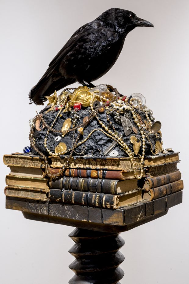 Mark Dion, The Old Crow, 2016. Stuffed crow, books, costume jewellery and objects on a wooden plinth. Courtesy of the artist and In Situ, Fabienne Leclerc, Paris. Photograph: Rory Conaty