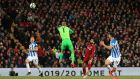 Liverpool's Mohamed Salah scores his side's third goal  during the Premier League match against Huddersfield Town at Anfield. Photograph: Peter Byrne/PA Wire