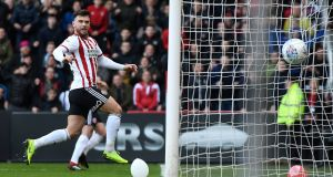 Scott Hogan of Sheffield United scores the opening goal during theChampionship win over Ipswich Town at Bramall Lane. Photo: George Wood/Getty Images