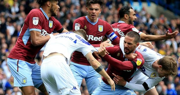 Leeds United's Mateusz Klich is confronted by Aston Villa's Conor Hourihane after he scored his side's first goal whilst Jonathan Kodjia was down injured. Photo: Clint Hughes/PA Wire