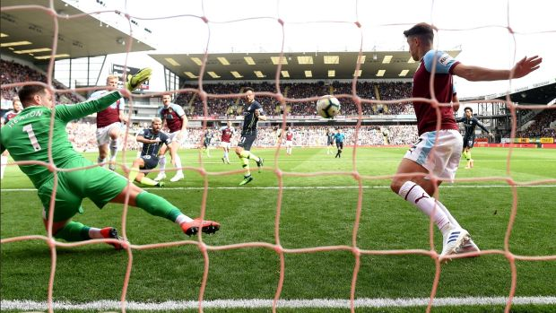 Matthew Lowton can't prevent Sergio Aguero from scoring Manchester City's opened at Turf Moor. Photograph: Michael Regan/Getty