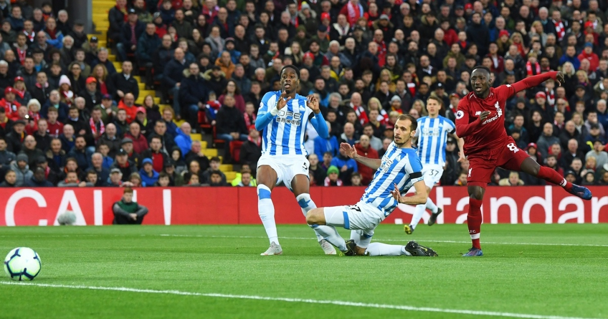 Naby Keita of Liverpool scores his team's first goal during the Premier League win over Huddersfield Town. Photo: Michael Regan/Getty Images