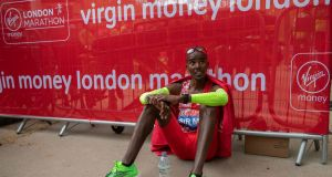 Mo Farah reacts after placing fifth in the Elite Men's Race during the 2019 Virgin Money London Marathon. Photo: Eddie Keogh/PA Wire
