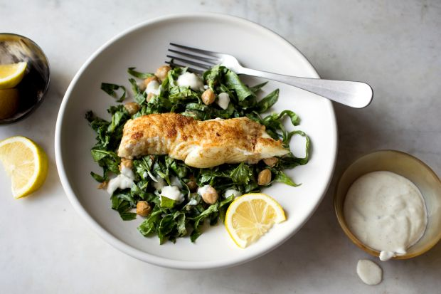 Yotam Ottolenghi's halibut with spiced chickpea and herb salad. Photograph: Andrew Scrivani/New York Times