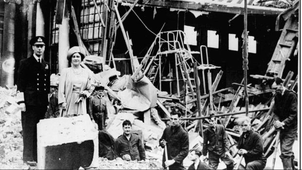 King George VI and Queen Elizabeth stand amid the wreckage caused by German bombs in September 1940.