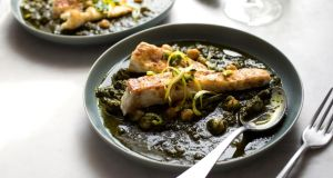 Yotam Ottolenghi's spiced halibut with spinach and chickpea stew. Photograph: Andrew Scrivani/New York Times