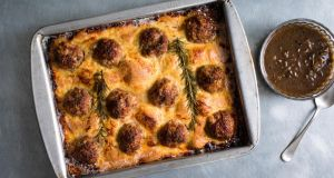 Yotam Ottolenghi's meatball toad-in-the-hole incorporates well-cooked meat, a crisp pancake and velvety gravy. Photograph: Andrew Scrivani/New York Times