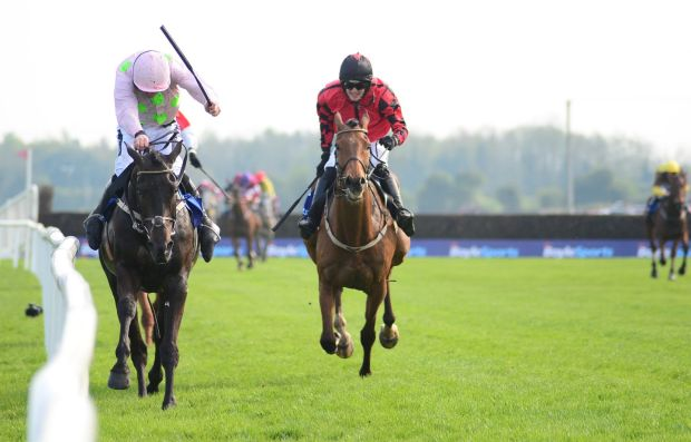 Burrows Saint and Ruby Walsh (both left) race during day two of the Fairyhouse Easter Festival at Firehouse Racecourse on April 22nd. Photograph: PA Wire.