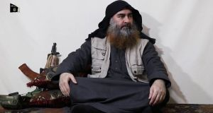 A still from a video published by Isis media wing Al Furqan network showing Isis leader Abu Bakr al-Baghdadi speaking from an undisclosed location. Photograph: Al Furqan Isis media wing/EPA
