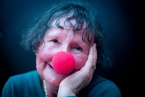 CLOWNING AROUND: Geraldine Fitzgerald poses during a Therapeutic Clowning Session with a red clown's nose at the Round Room at the Global Brain Institute, Trinty College Dublin. Photograph: Tom Honan