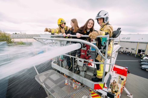 HIGH-PRESSURED JOB: Lauren Conlon of Kildare Town Community School and Emma Flynn of Holy Family Secondary School, Newbridge, are introduced to firefighting by Maria Clarke and Jennie Cooper of Dublin Fire Brigade at Newbridge Fire Station. Photograph: Eamon Ward