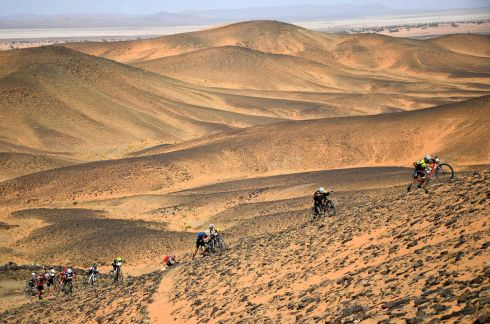 PUSH BIKES: Competitors push their bicycles over a sand dune during Stage 2 of the 14th edition of Titan Desert 2019 mountain biking race between Merzouga and Ouzina in Morocco. Photograph: Franck Fife/AFP/Getty Images