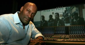 John Singleton: the director during postproduction for his film Four Brothers, in 2005. Photograph: Monica Almeida/NYT