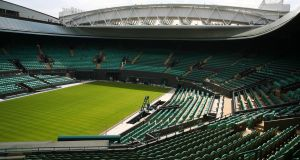 A general view inside the Wimbledon number one court with the new fixed and retractable roof. Photo: Clive Brunskill/Getty Images
