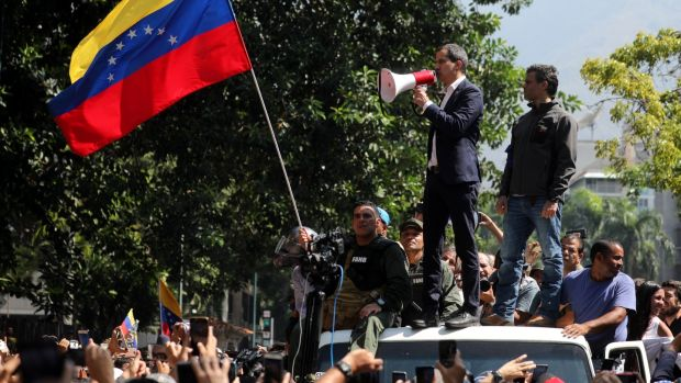 Juan Guiadó (left on van) and Leopoldo Lopez (right) at a protest in Caracas. Photograph: Miguel Gutierrez/EPA
