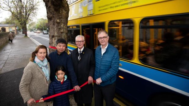 From left, Deirde Travers, Wei Yang and his daughter, Ciara Yang, Paddy McCartan and John Hogan beside one of the trees that may be cut down as part of the BusConnects programme, on Merrion Road, Dublin 4. Photograph: Tom Honan