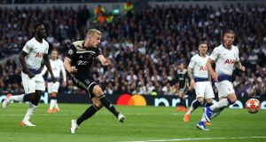Donny van de Beek scores Ajax's early opener against Spurs. Photograph: Julian Finney/Getty