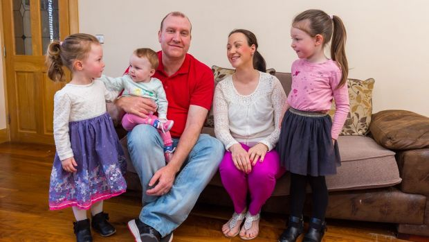 Martin Stones with his wife Caitriona and children Emma (3), Rosie (9 months) and Katie (5) at their home in Durrow, Co Offaly. Photograph: Tom O'Hanlon