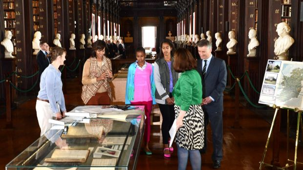 Former US First Lady Michelle Obama with her daughters, Sasha and Malia, on a visit to the Long Room at Trinity College in 2013 as part of a visit to view the Book of Kells. The popular attraction generates about €12 million net in revenue for Trinity each year. Photograph: Cyril Byrne
