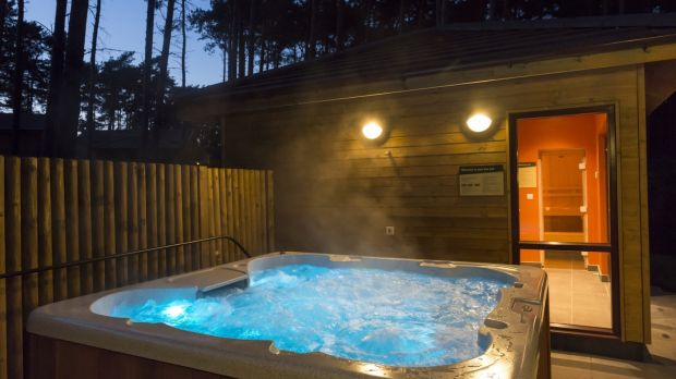 The four-bedroom lodges come with their own private hot tubs.