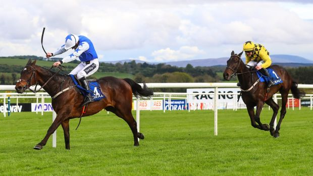 Ruby Walsh and Kemboy racing ahead of Paul Townend onboard Al Boum. Photograph: Tommy Dickson/Inpho