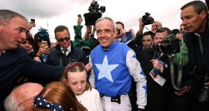 Jockey Ruby Walsh after winning The Punchestown Gold Cup with Kemboy and announcing his retirement alongside his daughters and father Ted. Photograph:  Tommy Dickson/Inpho