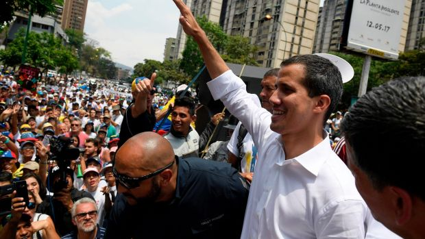 Venezuelan opposition leader Juan Guaidó gestures at supporters during a May Day rally. Photograph: Federico Parra/AFP/Getty Images