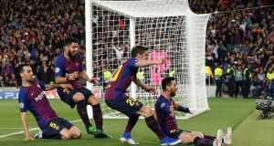 Barcelona's Lionel Messi celebrates scoring their third goal with Sergi Roberto, Luis Suarez and Sergio Busquets during the Champions League semi-final first leg at the Camp Nou. Photograph:   Susana Vera/Reuters
