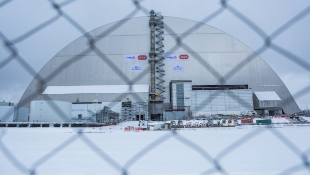 The New Safe Confinement sarcophagus covers the destroyed reactor on November 29, 2016 in Chernobyl, Ukraine. Photograph: Brendan Hoffman/Getty Images