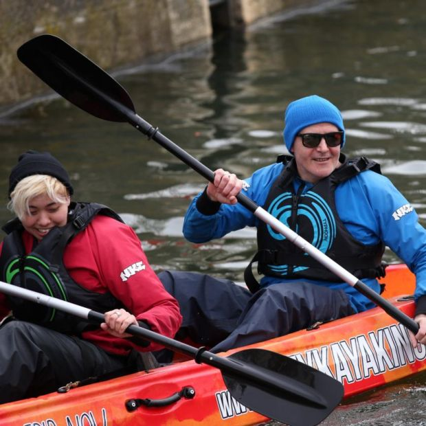 Kayaking on the Liffey: Conor Pope tours Dublin with Tessa Berry, a US tourist. Photograph: Laura Hutton