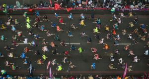 Runners cross Tower Bridge during the London Marathon. Photograph: Aaron Chown/PA