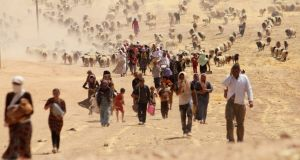 Displaced people from the minority Yazidi sect, fleeing violence from forces loyal to the Islamic State in Sinjar town, walk towards the Syrian border in 2014. File photograph: Rodi Said/Reuters