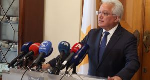 Ionas Nicolaou speaking to media at the presidential palace in Nicosia, Cyprus, after he resigned as justice minister over the failure of  police  to properly investigate missing person cases. Photograph: EPA/Katia Christodoulou