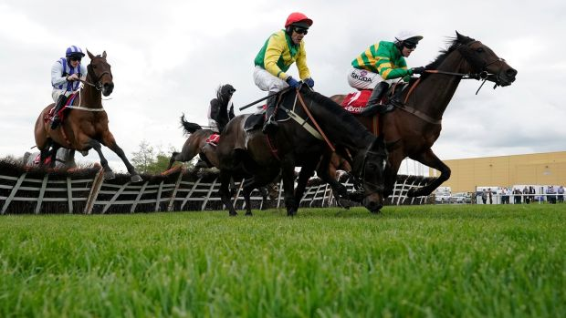 Mark Walsh riding Unowhatimeanharry (right) clears the last to win The Ladbrokes Champion Stayers Hurdle at Punchestown. Photo: Alan Crowhurst/Getty Images