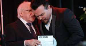 President Michael D Higgins chats with singer Jack L at the unveiling of a plaque for Leonard Cohen in Athy. Photograph: Laura Hutton