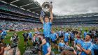 Dublin's Eoin Murchan celebrates with Brian Fenton and the Sam Maguire after the victory over Tyrone in the 2018 All-Ireland SFC Final. Photograph:  James Crombie/Inpho
