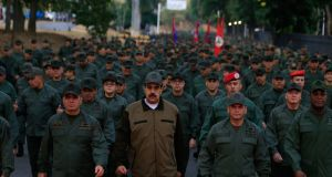 Venezuela's president, Nicolás Maduro, (C) with defence minister Vladimir Padrino (left) and members of the military  in Caracas, on Thursday. Photograph: Miraflores press office handout/AFP/Getty Images